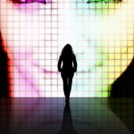 woman in front of large projection of face