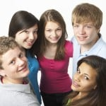 Five teens gathers looking up